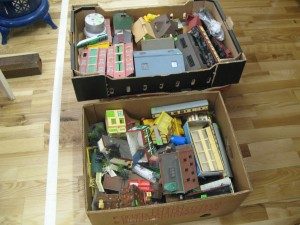 A collection of toy train buildings and rolling stock