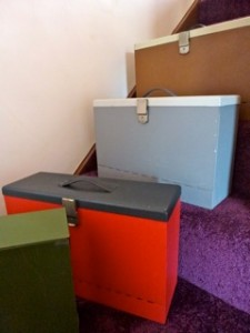 Four metal boxes, 3 with carrying handles, approx 38cm x 26cm x 12cm