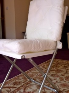 White folding chair with detachable cushions
