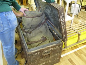 Military chest full of horse tack and saddlery