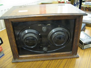 Early valve radio bakelite controls in oak box