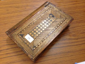 Decorative inlaid straw-work box. 19th Century book shapped with drawers and mirror. Sold for £310.