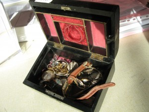 Lot 193 - Musical Jewellery Box with watches, jewellery and a gold chain. Sold for £510