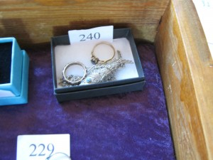 Lot 230 - Two rings and a silver fish brooch - Sold for £37