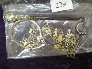 Lot 229 - 925 Silver Charm Bracelet, Charms and Lace Hook - Sold for £75