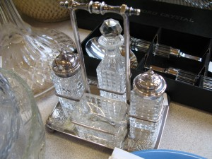 Lot 352 - Cut glass four piece cruet set in silver plated tray - Sold for £40