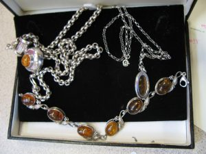 Lot 223 - Silver and Amber bracelets and necklace - Sold for £50