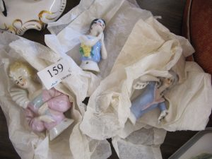 Lot 159 - Three half dolls - Sold for £25