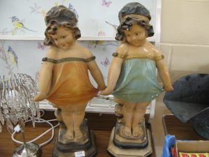 "Lot 114 - ""Cheeky girl"" statuettes - Sold for £27"