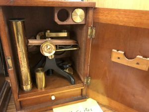 Lot 407 - Vintage brass microscope in case - Sold for £60