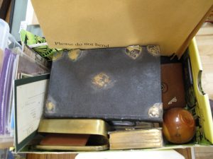 Lot 463 - Mysterious collection of ephemera and objects - Sold for £40