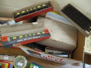 Lot 38 - Box of Trix carriages, tracks and other items - Sold for £40