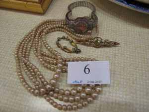Lot 6 - Pearly necklace and other jewellery - Sold for £30