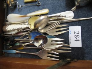 Lot 284 - Metal cutlery - Sold for £35