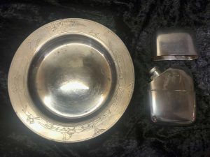 Silver salver and hip flask