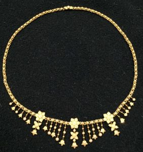 Gold and seeded pearl necklace. Estimate £300-£500