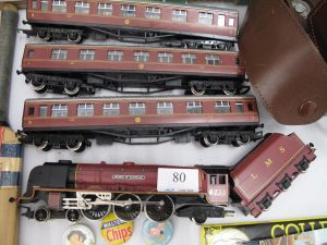 Lot 80 - Hornby OO Gauge Duchess loco and 3 coaches - Sold for £30