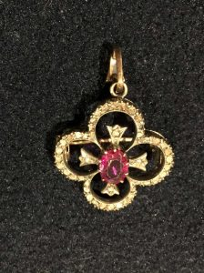Ruby and Diamond Pendant. Estimate £180-£220