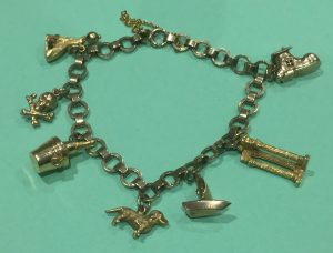 A traditional gold charm bracelet with seven charms on a lovely 9ct chain. The pick of the charms being the shoe, when opened it shows the old lady who lives in a shoe! Estimate £200-£250