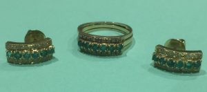 14ct gold emerald ring and earing set fitted in the sapphire mother