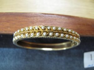 Lot 152 - Gold and seed pearl bangle - Sold for £155