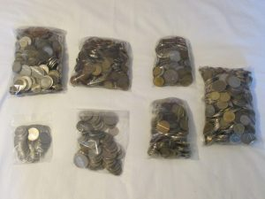 Seven bags of old coins