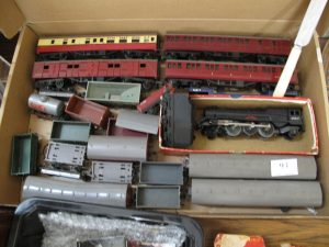 Lot 93 - Triang OO Guage loco, trucks and coaches - Sold for £40