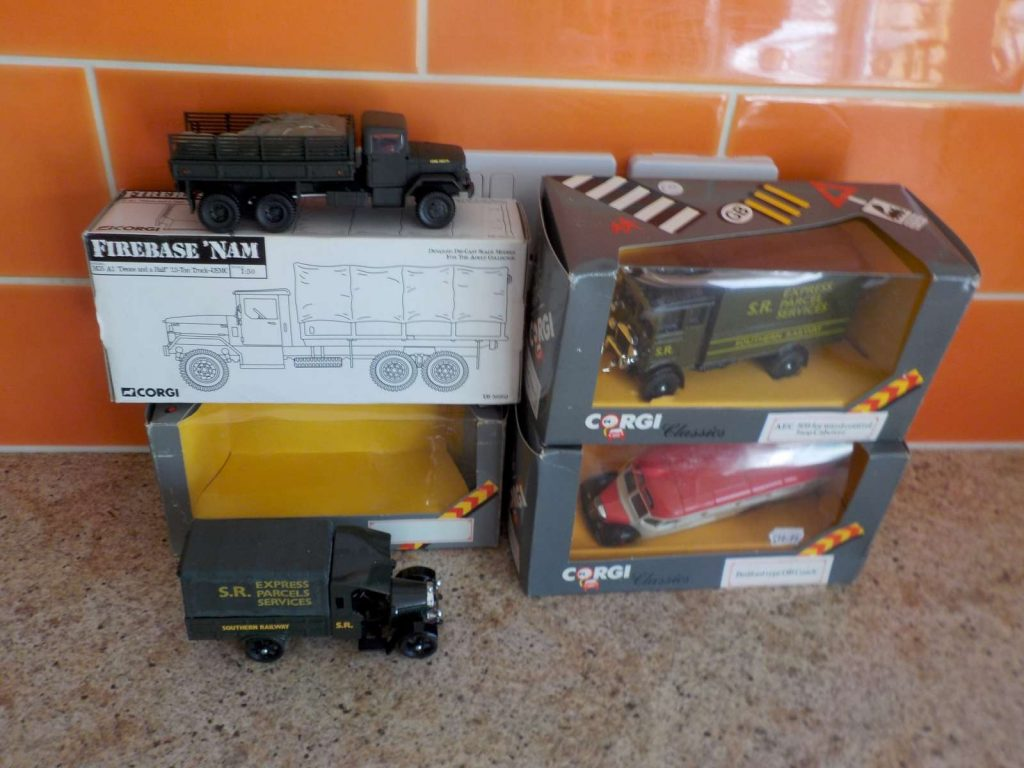 Corgi lorries and a coach in boxes