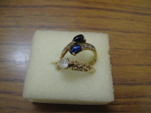 Lot 264 - 2 gold rings with white and blue sapphires - Sold for £40