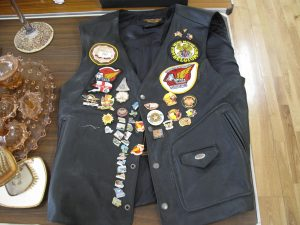 Lot 201 - Leather biker waistcoat with badges - Sold for £45