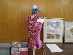 Lot 166 - Pink mannequin with hallmarked silver and costume jewellery - Sold for £45