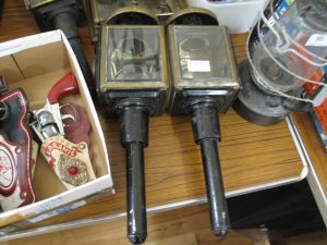 Lot 67 - Pair of stage coach lamps with brass trim to hoods - Sold for £55