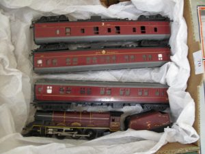 Lot 70 - Triang Maroon Prices Locomotive and three coaches - Sold for £55
